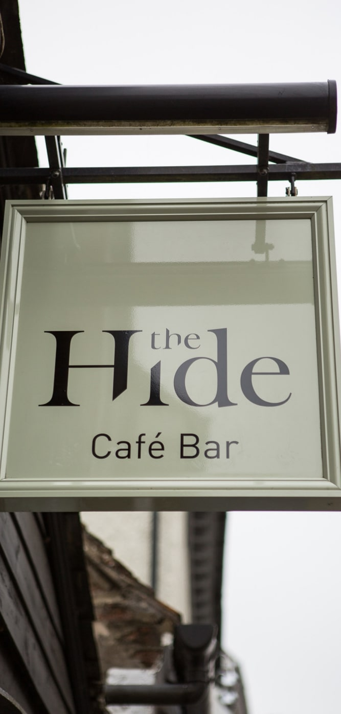 The Hide Hanging Signage